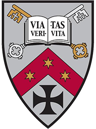The Gregorian Institute Shield, composed of the crossed gold and silver keys of the Papal Insignia, an open book with the words 'Via Veritas Vita' ('The Way, the Truth, and the Life') written on its pages, three golden six-sided stars on a red banner, and a Germanic cross.